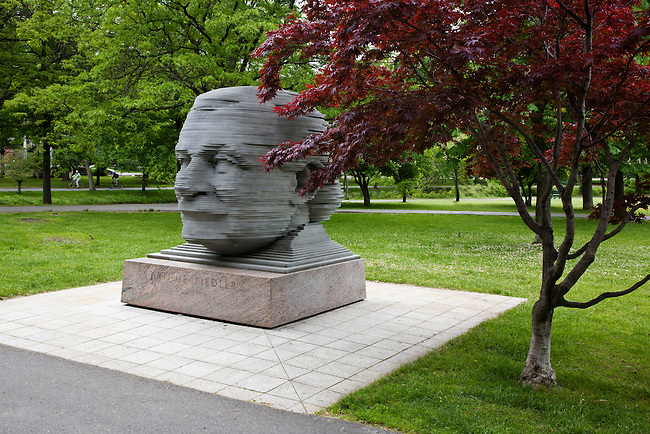 Statue of ARTHUR FIEDLER the conductor of the Boston Pops orchestra in CHARLES RIVER PARK - BOSTON, MASSACHUSETTS
