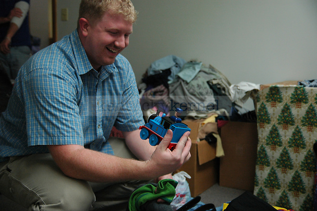 Public Health Graduate student Nick Gould finds a toy while sorting through the clothes donated to the Wildcat Warmth project at the Reynolds building on Thursday, November 12th 2009. Photo by Jon Reynolds | Staff