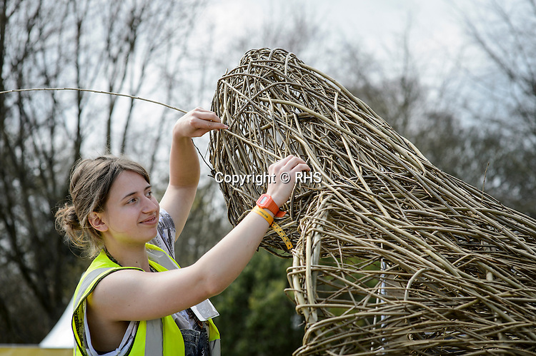 Imogen Higgins weaving Surf our Turf. Designed by Rebecca Vincent. RHS Flower Show Cardiff 2016.