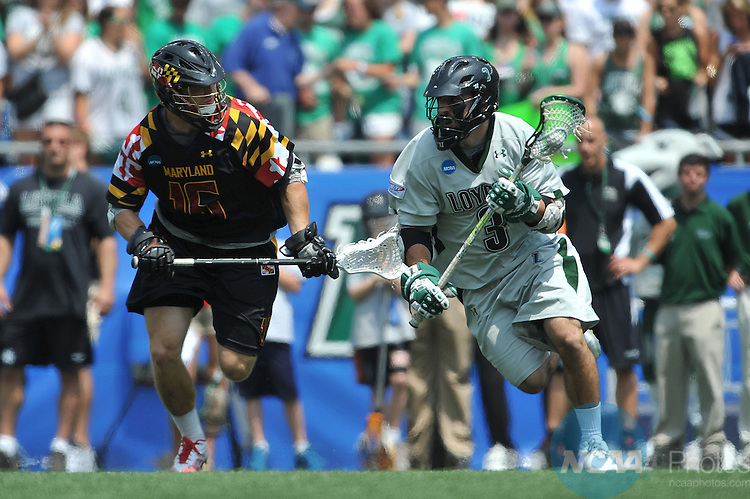28 MAY 2012:  Chris Layne (3) of Loyola University and Landon Carr (16) of the University of Maryland battle for the ball during the Division I Men?s Lacrosse Championship held at Gillette Stadium in Boston, MA.  Loyola defeated Maryland 9-3 for the national title.  Larry French/NCAA Photos