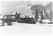 D&amp;RGW #486 with northbound train of coal empties, including a flanger, for Crested Butte crossing the bridge at Almont.<br /> D&amp;RGW  Almont, CO  Taken by Richardson, Robert W.