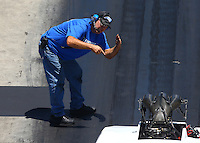 Jun 18, 2016; Bristol, TN, USA; Crew member for NHRA pro mod driver Chip King during qualifying for the Thunder Valley Nationals at Bristol Dragway. Mandatory Credit: Mark J. Rebilas-USA TODAY Sports