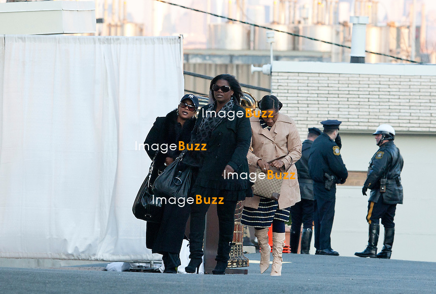 NEWARK, NJ - FEBRUARY 17: Family members of Whitney Houston arrive escorted by the police at Whigham Funeral Home for a private viewing for  Whitney Houston on February 17, 2012 in Newark, New Jersey. Whitney Houston was found dead in her hotel room at The Beverly Hilton hotel on February 11, 2012..................