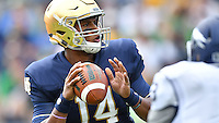 DeShone Kizer (14) looks to throw.