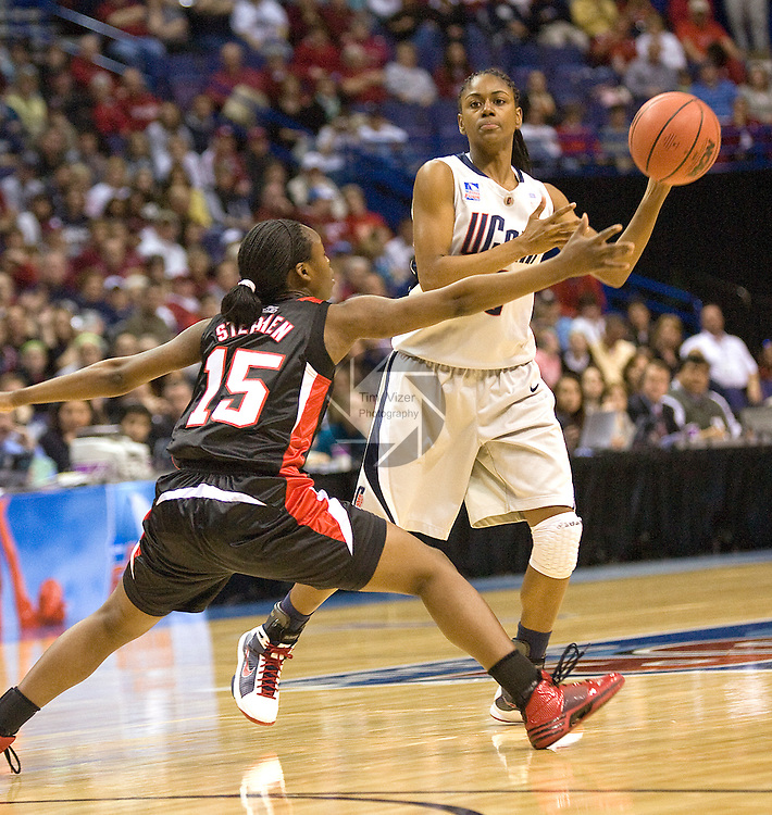 040709TVWOMENFINALFOUR2.UConn's Tiffany Hayes (3, right) passes inside past Lousville's Tiera Stephen (15, left) early in the first half at the NCAA Women's Final Four at the Scottrade Center in St. Louis, MO on Tuesday April 7, 2009..MCT/TIM VIZER