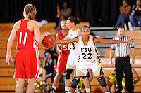 28 January 2012:  FIU guard Jerica Coley (22) defends WKU guard Ellen Sholtes (11) in the second half as the FIU Golden Panthers defeated the Western Kentucky University Hilltoppers, 60-56, at the U.S. Century Bank Arena in Miami, Florida.  Coley, who has scored the second-most points of any women's player in the country, finished the game with 36 points and surpassed the 1,000 point mark.