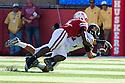 30 October 2010: Nebraska linebacker Lavonte David (4) breaks up a pass to Missouri tight end Michael Egnew (82) at Memorial Stadium in Lincoln, Nebraska. Nebraska defeated Missouri 31 to 17.