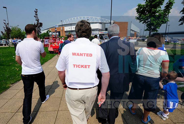 A fan waking around with ticket wanted sign on his top during the Premier League match at The JJB Stadium, Wigan. Picture date 11th May 2008. Picture credit should read: Simon Bellis/Sportimage