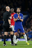 Cesc Fabregas of Chelsea has words with referee, Anthony Taylor during Chelsea vs Manchester United, Premier League Football at Stamford Bridge on 5th November 2017