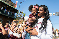 Teaira McCowan saying hi to a special fan at the downtown celebration for the women's basketball team.<br />  (photo by Beth Wynn / &copy; Mississippi State University)