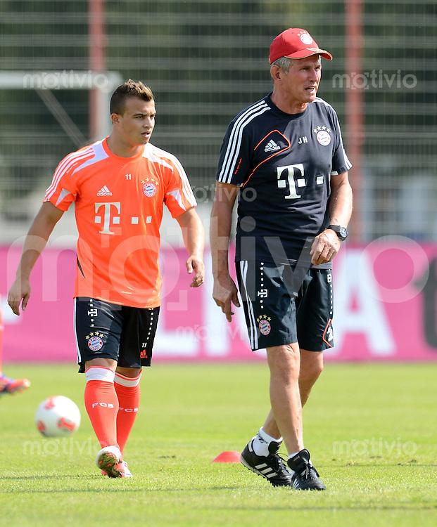 FUSSBALL  1. BUNDESLIGA   SAISON  2012/2013  04.07.2012 Training beim FC Bayern Muenchen  Xherdan Shaqiri mit Trainer Jupp Heynckes  (v. li.)