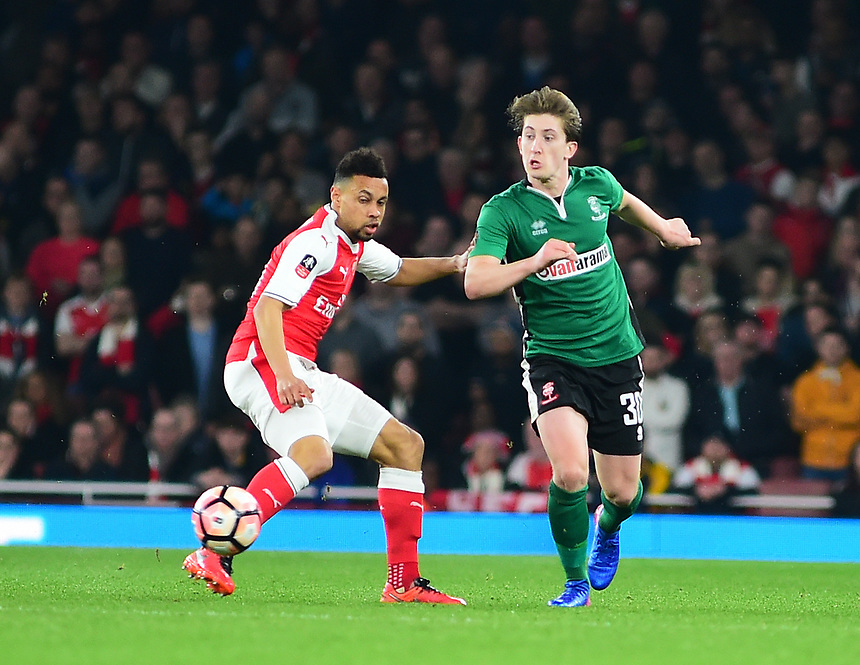 Lincoln City's Alex Woodyard vies for possession with Arsenal's Francis Coquelin<br /> <br /> Photographer Andrew Vaughan/CameraSport<br /> <br /> The Emirates FA Cup Quarter-Final - Arsenal v Lincoln City - Saturday 11th March 2017 - The Emirates - London<br />  <br /> World Copyright &copy; 2017 CameraSport. All rights reserved. 43 Linden Ave. Countesthorpe. Leicester. England. LE8 5PG - Tel: +44 (0) 116 277 4147 - admin@camerasport.com - www.camerasport.com