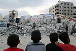 Palestinians attend concert next to the rubble of Said al-Mishal Cultural Center which was destroyed by an Israeli air strike in Gaza city on Aug. 15, 2018. Photo by Mahmoud Khattab