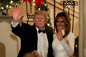 United States President Donald J. Trump and First Lady Melania Trump wave to the guests at the Congressional Ball at White House in Washington on December 15, 2018. <br /> Credit: Yuri Gripas / Pool via CNP