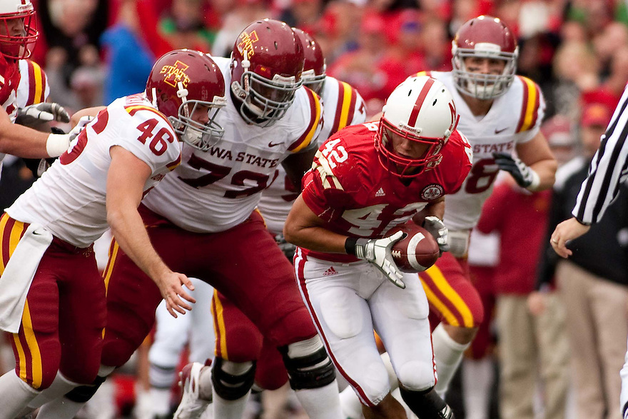 24 October 2009: Nebraska linebacker Sean Fisher pickup a blocked Iowa State field goal attempt in the second half at Memorial Stadium, Lincoln, Nebraska. Iowa State defeated Nebraska 9 to 7.
