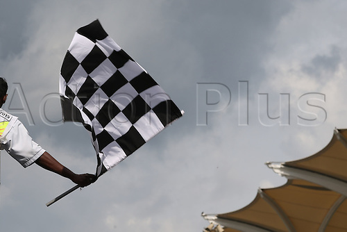 29.03.2015. Sepang, Kuala Lumpur, Malaysia. Formula One grand prix of Malayasia race day.  Chequered flag held by race controller at the end of the race