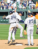 Baltimore, MD - April 9, 2009 -- New York Yankee second baseman Robinson Cano (24), right fielder Nick Swisher (33), and first baseman Mark Teixeira (25) celebrate the Yankees first victory of th season against the Baltimore Orioles at Oriole Park at Camden Yards in Baltimore, MD on Thursday, April 9, 2009.  The Yankees won the game 11 - 2..Credit: Ron Sachs / CNP.(RESTRICTION: NO New York or New Jersey Newspapers or newspapers within a 75 mile radius of New York City)