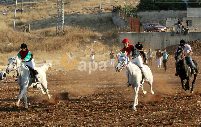 A Palestinians ride Arabian horses during the horse-race in the west bank city of Nablus on July 11, 2009. Photo by Nedal Shtieh