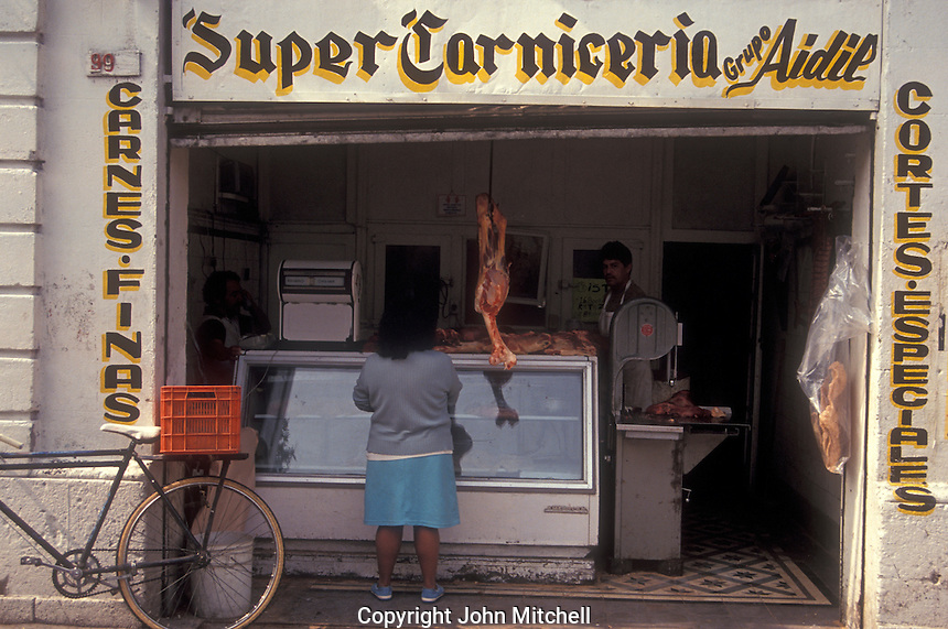 Woman buying meat at a Mexican butcher shop or carniceria in Mexico City
