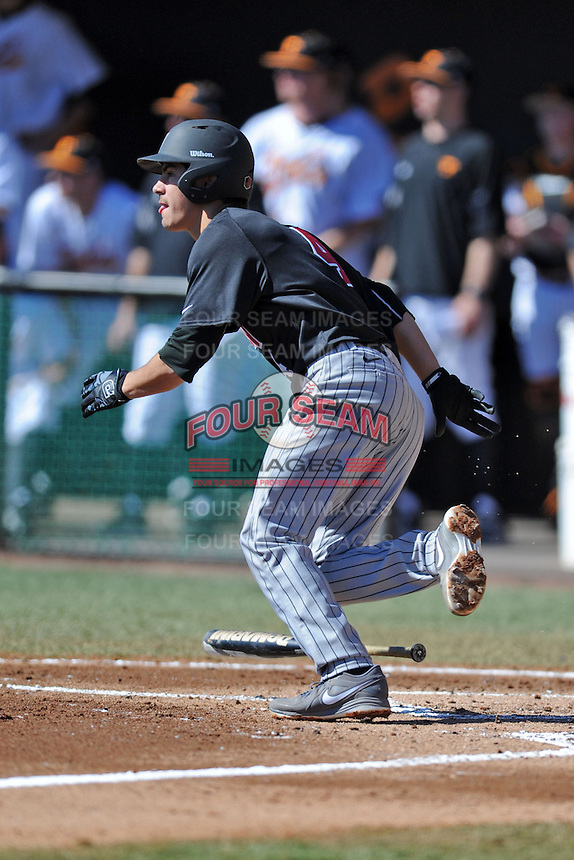 UNLV Runnin' Rebels shortstop Matt McCallister #4 runs to first during a game against the Tennessee Volunteers at Lindsey Nelson Stadium on February 22, 2014 in Knoxville, Tennessee. The Volunteers defeated the Rebels 5-4. (Tony Farlow/Four Seam Images)
