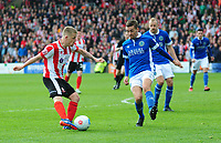 Lincoln City's Terry Hawkridge scores his sides second goal under pressure from Macclesfield Town's David Fitzpatrick<br /> <br /> Photographer Andrew Vaughan/CameraSport<br /> <br /> Vanarama National League - Lincoln City v Macclesfield Town - Saturday 22nd April 2017 - Sincil Bank - Lincoln<br /> <br /> World Copyright &copy; 2017 CameraSport. All rights reserved. 43 Linden Ave. Countesthorpe. Leicester. England. LE8 5PG - Tel: +44 (0) 116 277 4147 - admin@camerasport.com - www.camerasport.com