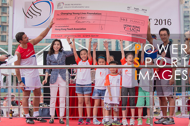 The Changing Young Lives Foundation receives a check during Swire Touch Tournament on 03 September 2016 in King's Park Sports Ground, Hong Kong, China. Photo by Marcio Machado / Power Sport Images