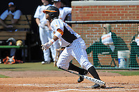 Khayyan Norfork #8 of the Tennessee Volunteers follows through on a swing at Lindsey Nelson Stadium against the the Manhattan Jaspers on March 12, 2011 in Knoxville, Tennessee.  Tennessee won the first game of the double header 11-5.  Photo by Tony Farlow / Four Seam Images..