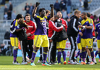 Pictured: Wilfried Bony of Swansea thanks away supporters after the final whistle. Saturday 19 April 2014<br /> Re: Barclay's Premier League, Newcastle United v Swansea City FC at St James Park, Newcastle, UK.