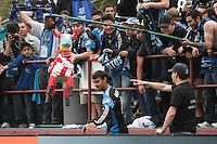 Fans hoist a pinata for Chris Wondolowski. Chivas USA defeated the San Jose Earthquakes 2-1 at Buck Shaw Stadium in Santa Clara, California on April 23rd, 2011.