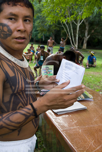 "Altamira, Brazil. ""Xingu Vivo Para Sempre"" protest meeting about the proposed Belo Monte hydroeletric dam and other dams on the Xingu river and its tributaries. Indian camp at Bethania seminary. Young Yudja leader prepares a statement."