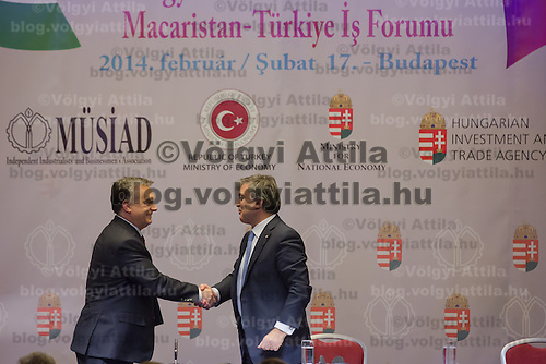 Abdullah Gul (R) president of Turkey and Viktor Orban (L) prime minister of Hungary shake hands during a business conference in Budapest, Hungary on February 17, 2014. ATTILA VOLGYI