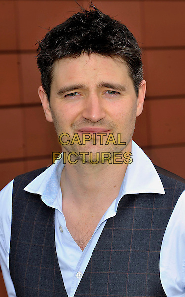 TOM CHAMBERS .Photocall to Launch a new production of 'Top Hat the Musical' at Milton Keynes Theatre, Bucks, UK, May 6th 2011..portrait headshot stubble blue  grey gray waistcoat shirt .CAP/JIL.©Jill Mayhew/Capital Pictures