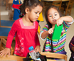 Preschool 3  year olds pretend play area two girls playing and talking