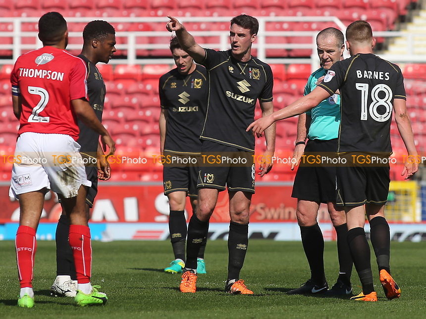 Darren Potter of MK Dons urges Swindon's Nathan Thompson to move away during Swindon Town vs MK Dons, Sky Bet EFL League 1 Football at the County Ground on 8th April 2017