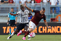 Calcio, Serie A: Roma vs Juventus. Roma, stadio Olimpico, 30 agosto 2015.<br /> Roma&rsquo;s Radja Nainggolan, right, is challenged by Juventus&rsquo; Paul Pogba during the Italian Serie A football match between Roma and Juventus at Rome's Olympic stadium, 30 August 2015.<br /> UPDATE IMAGES PRESS/Riccardo De Luca