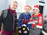 Olive, Ben and Finn Walsh who took part in the Termonfeckin Celtic FC Santa run. Photo:Colin Bell/pressphotos.ie
