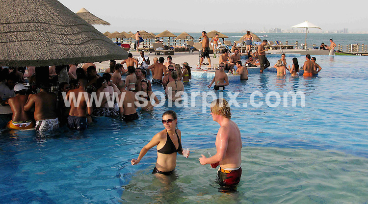 **ALL ROUND PICTURES FROM SOLARPIX.COM**.**WORLDWIDE SYNDICATION RIGHTS**.Expats enjoy themselves in the swimming pool and down drinks at a Island party on Al Maya Island, Abu Dhabi, United Arab Emirates. 22nd August 2008..This pic: Expats..JOB REF: 8299 DBL     DATE: 22_08_2008.**MUST CREDIT SOLARPIX.COM OR DOUBLE FEE WILL BE CHARGED* *ONLINE USAGE FEE £50.00 PER PICTURE - NOTIFICATION OF USAGE TO PHOTO@SOLARPIX.COM*