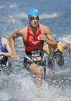 26 MAR 2006 - MOOLOOLABA, AUSTRALIA - Sebastien Gacond (SUI) heads for T1 at the Mooloolaba ITU World Cup triathlon. (PHOTO (C) NIGEL FARROW)