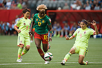 June 12, 2015: Gaelle ENGANAMOUIT of Cameroon runs with the ball during a Group C match at the FIFA Women's World Cup Canada 2015 between Cameroon and Japan at BC Place Stadium on 12 June 2015 in Vancouver, Canada. Japan won 2-1. Sydney Low/AsteriskImages