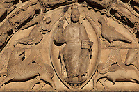 Christ in a mandorla, surrounded by the 4 symbols of the evangelists (winged man, eagle, lion and bull)on the tympanum of the central bay of the Royal Portal, 1142-50, Western facade, Chartres cathedral, Eure-et-Loir, France. The central bay represents the End of Time as described by the Book of Revelations. Chartres cathedral was built 1194-1250 and is a fine example of Gothic architecture. It was declared a UNESCO World Heritage Site in 1979. Picture by Manuel Cohen