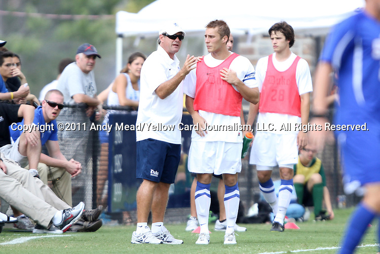 04 September 2011: Duke head coach John Kerr, Jr. (left) talks to Jan Trnka-Amrhein. The Southern Methodist University Mustangs defeated the Duke University Blue Devils 1-0 in overtime at Koskinen Stadium in Durham, North Carolina in an NCAA Division I Men's Soccer game.