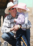 Katelyn Cornmesser of Fallon gets a hug after competing in the Pee-Wee Stick Horse Barrel race at the Fallon Junior Rodeo.  Photo by Tom Smedes.