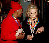 1997 Kennedy Center honorees Jessye Norman, left, and Lauren Bacall, right following a group photo-op at the United States Department of State in Washington, D.C. on December 6, 1997..Credit: Jim Kelly / Pool via CNP