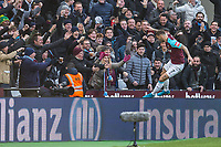 Marko Arnautovic of West Ham United jumps in with fans to celebrate his goal during the Premier League match between West Ham United and Chelsea at the Olympic Park, London, England on 9 December 2017. Photo by Andy Rowland.