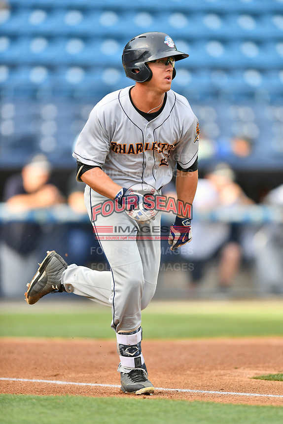 Charleston RiverDogs right fielder Blake Rutherford (23) runs to first base during a game against the Asheville Tourists at McCormick Field on July 5, 2017 in Asheville, North Carolina. The RiverDogs defeated the Tourists 10-9. (Tony Farlow/Four Seam Images)