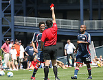 17 June 2007: Referee Niko Bratsis (in red) shows the red card to New England's Miguel Gonzalez (behind) as Marshall Leonard (22) moves in to join the discussion. The New England Revolution Reserves defeated the Columbus Crew Reserves 2-1 on the Gillette Stadium practice field in Foxboro, Massachusetts in a Major League Soccer Reserve Division game.