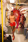 London, England. 31 August 2015. Megan from Socaholics on the Tube to the event - not worried about the rain. Performers and revellers were in good spirits despite a second years of heavy rain on the Adult Day of Notting Hill Carnival. Photo: Bettina Strenske