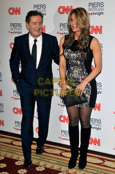 PIERS MORGAN & CELIA WALDEN .attending the launch of 'Piers Morgan Tonight' on CNN at Mandarin Oriental Hyde Park, London, England, UK, December 7th, 2010..full length couple married husband wife navy blue suit black tie sleeveless lace print mini knee high boots clutch bag .CAP/PL.©Phil Loftus/Capital Pictures.