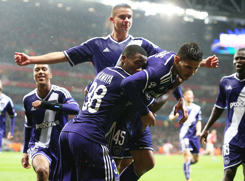 Anderlecht's Aleksandar Mitrovic celebrates scoring his sides equalising goal to make the score 3-3 in the last minute of the match to recover from being 3-0 down with team-mate Andy Kawaya<br /> <br /> Photographer Kieran Galvin/CameraSport<br /> <br /> Football - UEFA Champions League Group D - Arsenal v Anderlecht - Tuesday 4th November 2014 - Emirates Stadium - London<br /> <br /> &copy; CameraSport - 43 Linden Ave. Countesthorpe. Leicester. England. LE8 5PG - Tel: +44 (0) 116 277 4147 - admin@camerasport.com - www.camerasport.com