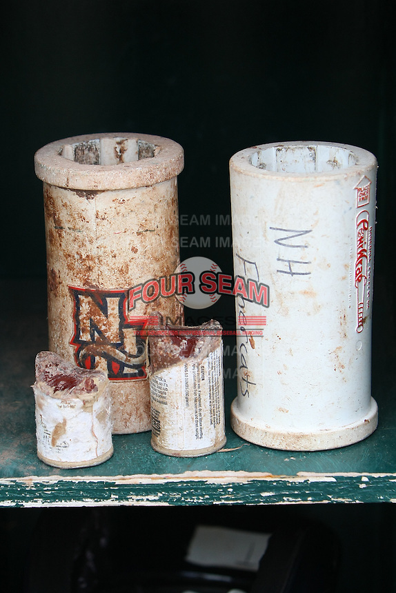 New Hampshire Fisher Cats bat weights and pine tar sit in the dugout prior to a game against the Bowie Baysox at Prince George's Stadium on June 17, 2012 in Bowie, Maryland. New Hampshire defeated Bowie 4-3 in 13 innings. (Brace Hemmelgarn/Four Seam Images)